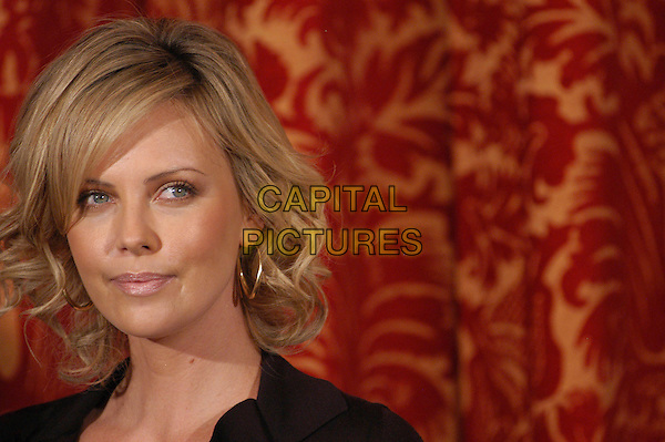 """CHARLIZE THERON.Photocall for """"North Country"""" at Hotel St. Regis, Rome, .Italy..February 6th, 2006.Ref: CAV.headshot portrait.www.capitalpictures.com.sales@capitalpictures.com.© Capital Pictures."""