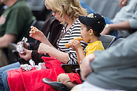 A young Wake Forest Demon Deacons fan takes advantage of $1 Hot Dog Sunday during the game against the Miami Hurricanes at Wake Forest Baseball Park on March 22, 2015 in Winston-Salem, North Carolina.  The Demon Deacons defeated the Hurricanes 10-4.  (Brian Westerholt/Four Seam Images)