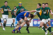 Joseph Faliu is tackled by James Ngatupuna & Daniel Kauraka. Oceania Cup & RWC Qualifier rugby game between the Cook Islands & Niue played at Growers Stadium, Pukekohe, on Saturday 27th June 2009. The Cook Islands won 29 - 7 after leading 9 - 7 at halftime.