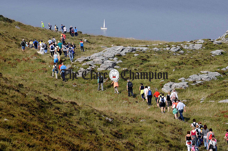 Participants move along the sides of Black Head Mountain during the Burren Ramble, held in aid of the Lifeboats. Photograph by John Kelly.