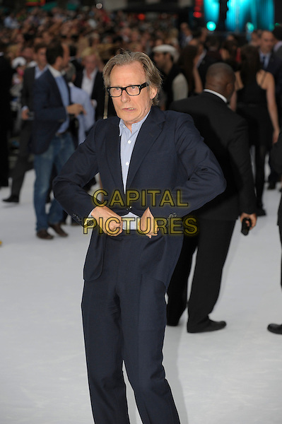Bill Nighy.'Total Recall' UK premiere at Vue cinema, Liecester Square, London, England..16th August 2012.half length 3/4 black suit blue shirt glasses hands arms funny pulling up adjusting .CAP/PL.©Phil Loftus/Capital Pictures.