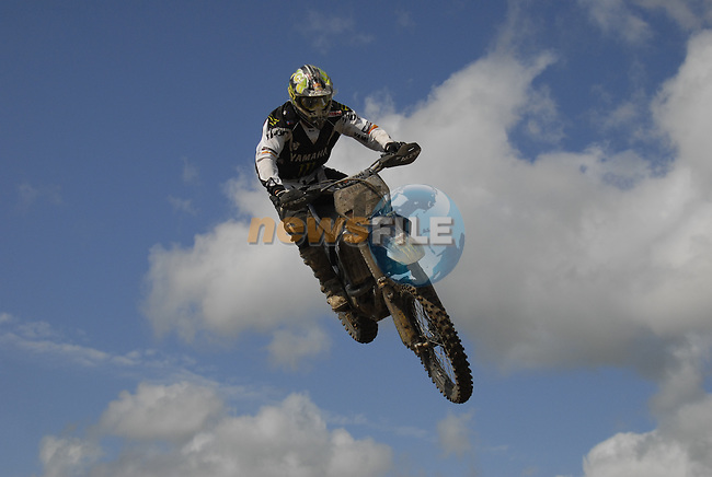 Joshua Coppins (NZL) flies high over the table top jump in the MX1 Grand Prix Race1 during the Motocross Grand Prix at Fairyhouse Race Course, Co.Meath, Ireland, 31st August 2008.(Photo Eoin Clarke/Newsfile)