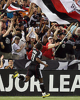 Luciano Emilio #11  of D.C. United greets the fans after scoring the first goal during an international friendly match against A.C. Milan at RFK Stadium, on May 26 2010 in Washington DC. United won 3-2.