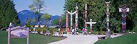 Tourists visiting Totem Poles at Brockton Point in Stanley Park, Vancouver, British Columbia, Canada, in Summer