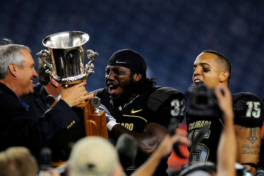 31 Aug 2008: Colorado governor Bill Ritter presents the Rocky Mountain Showdown trophy to members of the Colorado Buffaloes, Ryan Walters (15) and Maurice Cantrell (32) after Colorado defeated the Colorado State Rams. The Colorado Buffaloes defeated the Colorado State Rams 38-17 at Invesco Field at Mile High in Denver, Colorado. FOR EDITORIAL USE ONLY
