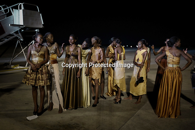 MAPUTO, MOZAMBIQUE – DECEMBER 12: Models wait backstage before a show at Mozambique fashion week held on the tarmac of the airport, on December 12, 2015 in Maputo, Mozambique. The yearly event brings designers from Southern Africa and Portugal. (Photo by: Per-Anders Pettersson)