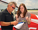 "Albarta Dempsey, 15, of Centerville, reacts to learning about some of the programs and benefits associated with being a part of the EAA Young Eagles Program, prior to her flight with aviation legend Seans D. Tucker at the Dayton International Airport on Wednesday. Miss Alberta Dempsey, 15, of Centerville takes a Young Eagles flight with National Chairman Sean D. Tucker at the Dayton International Airport on June 25, 2014. Dempsey wrote an essay that was chosen as the best of all entrants from around the Dayton area to earn her ride with National Aviation Hall of Famer, and air show legend Sean D. Tucker. The Young Eagles program is part of the Experimental Aircraft Association for which Tucker serves as national chairman. The EAA's Young Eagles program has given a first flight to nearly 2 million kids. All pilots associated with the program are volunteers.Tucker said that it was an honor to be the person to give a Young Eagles flight to Dempsey, whom he described as bright and intelligent. Once back on the ground, Dempsey said that her flight was ""amazing."""