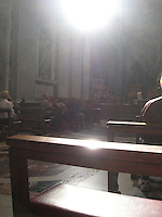 """The Light""            A single ray of light suddenly appears through the dome, illuminating those praying at St. Peter's Basilica"