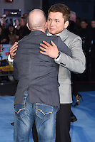 "Eddie the Eagle Edwards and Taron Egerton<br /> at the ""Eddie the Eagle"" European premiere, Odeon Leicester Square London<br /> <br /> <br /> ©Ash Knotek  D3099 17/03/2016"