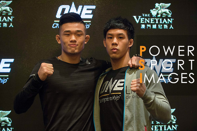 (l-r) Christian Lee and Eddie Ng, fighters of One Championship - Heroes of the World pose for photos during the press conference on 04 August 2016 held at Conrad Hotel, Hong Kong, China. Photo by Marcio Machado / Power Sport Images