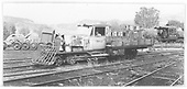 RGS Goose #6 moving away from turntable with caboose #0404 under repair in background.<br /> RGS  Ridgway, CO  Taken by Maxwell, John W. - 7/14/1946