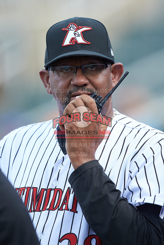 Kannapolis Intimidators pitching coach Jose Bautista (38) communicates with the bullpen during the game against the West Virginia Power at Kannapolis Intimidators Stadium on July 25, 2018 in Kannapolis, North Carolina. The Intimidators defeated the Power 6-2 in 8 innings in game one of a double-header. (Brian Westerholt/Four Seam Images)
