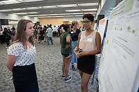 """Cobaltocinium Derivatives as Mediators for Biocatalysis with P450 Enzymes"" by Ayanna Lynch<br /> (Mentor: Andrew Udit, Chemistry)<br /> Occidental College's Undergraduate Research Center hosts their annual Summer Research Conference, Aug. 1, 2018. Student researchers presented their work as either oral or poster presentations at the final conference. The program lasts 10 weeks and involves independent research in all departments.<br /> (Photo by Marc Campos, Occidental College Photographer)"