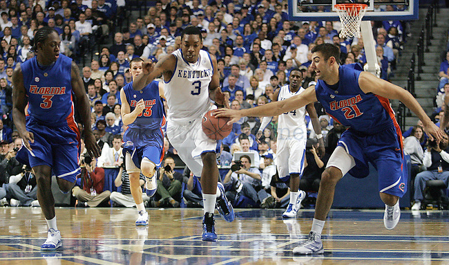 Freshman guard Darnell Dodson gets the ball snagged from him by Dan Werner in the second half of UK's win over Florida at Rupp Arena on Sunday, March 7, 2010. Photo by Britney McIntosh | Staff