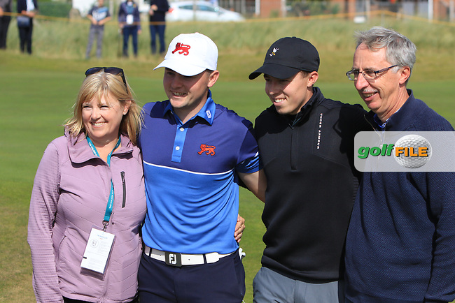 Alex Fitzpatrick (GB&I) with his Mum and Dad and brother Matthew on the 17th after winning their opening match during the Foursomes at the Walker Cup, Royal Liverpool Golf CLub, Hoylake, Cheshire, England. 07/09/2019.<br /> Picture Thos Caffrey / Golffile.ie<br /> <br /> All photo usage must carry mandatory copyright credit (© Golffile   Thos Caffrey)