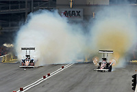 Apr. 7, 2013; Las Vegas, NV, USA: NHRA top fuel dragster driver Spencer Massey (right) and Clay Millican smoke the tires early in a pedal fest during the Summitracing.com Nationals at the Strip at Las Vegas Motor Speedway. Mandatory Credit: Mark J. Rebilas-