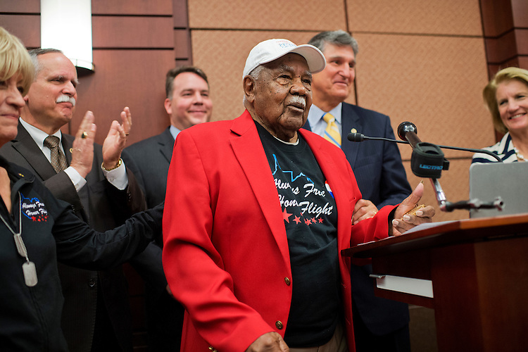 UNITED STATES - MAY 20: Sgt. John M. Watson, 96, of Beckley, W.Va., makes remarks during a luncheon in the Capitol Visitor Center where Watson received a Congressional Gold Medal and was recognized by the Tuskegee Airmen Association, May 20, 2015. Also attending from left are Dreama Denver, of Always Free Honor Flight, Reps. David McKinley, R-W.Va., Alex Mooney, R-W.Va., Sens. Joe Manchin, D-W.Va., and Shelley Moore Capito, R-W.Va.. Rep. Evan Jenkins, R-W.Va., also attended. (Photo By Tom Williams/CQ Roll Call)