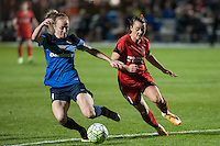 Kansas City, Mo. - Saturday April 23, 2016: FC Kansas City defender Becky Sauerbrunn (4) and Portland Thorns FC forward Hayley Raso (21) fight for possession during a match at Swope Soccer Village. The match ended in a 1-1 draw.