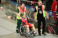 Picture by SWpix.com - 02/03/2018 - Cycling - 2018 UCI Track Cycling World Championships, Day 3 - Omnisport, Apeldoorn, Netherlands - Woman's Omnium Elimination Race - China's Xiaofei Wang taken off the track in a wheelchair after a crash