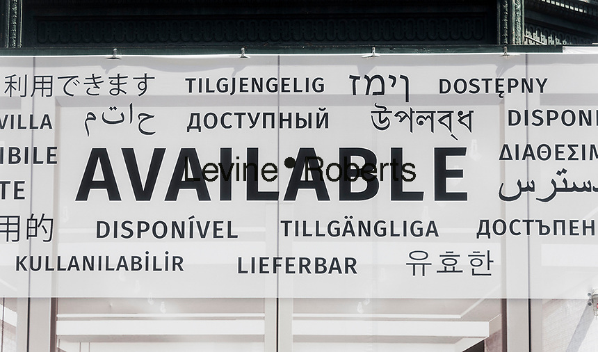 A landlord advertises a vacant storefront in Midtown Manhattan in New York with a multi-lingual sign proclaiming its availability, seen on Friday, July 22, 2016. (© Richard B. Levine)