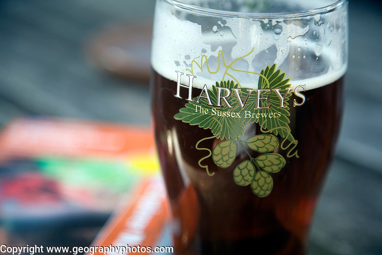 Close up pint glass of Harveys Sussex beer