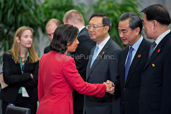 Susan Rice, United States national security advisor, left, greets Wang Yi, China's foreign minister, as she arrives to a P5+1 multilateral meeting at the Nuclear Security Summit in Washington, D.C., U.S., on Friday, April 1, 2016. After a spate of terrorist attacks from Europe to Africa, Obama is rallying international support during the summit for an effort to keep Islamic State and similar groups from obtaining nuclear material and other weapons of mass destruction. <br /> Credit: Andrew Harrer / Pool via CNP/MediaPunch