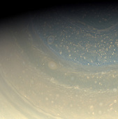 Pasadena, CA - January 9, 2009 -- Saturn's north pole is littered with storms, as we see in this color view of  the pole. A bit of the north polar hexagon is also visible at the upper-right.  Cassini scientists are looking forward to sunrise on this pole next year so that they can better study it in visible light.  Images taken using red, green and blue spectral filters were combined to create this full color view. The images were obtained with the Cassini spacecraft wide-angle camera on November 16, 2008 at a distance of approximately 673,000 kilometers (418,000 miles) from Saturn and at a Sun-Saturn-spacecraft, or phase, angle of 71 degrees. Image scale is 37 kilometers (23 miles) per pixel..Credit: NASA/JPL/Space Science Institute via CNP