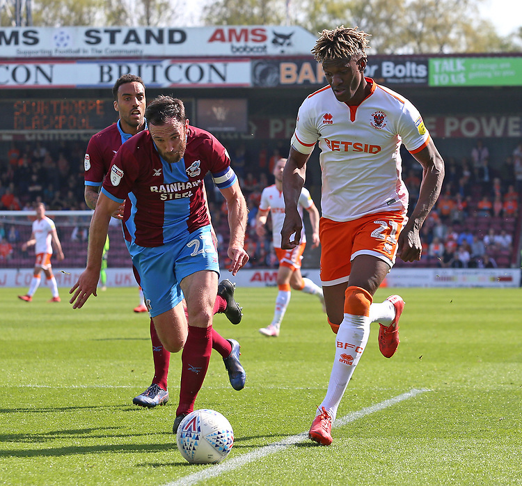Blackpool's Armand Gnanduillet gets away from Scunthorpe United's Rory McArdle<br /> <br /> Photographer David Shipman/CameraSport<br /> <br /> The EFL Sky Bet League One - Scunthorpe United v Blackpool - Friday 19th April 2019 - Glanford Park - Scunthorpe<br /> <br /> World Copyright © 2019 CameraSport. All rights reserved. 43 Linden Ave. Countesthorpe. Leicester. England. LE8 5PG - Tel: +44 (0) 116 277 4147 - admin@camerasport.com - www.camerasport.com