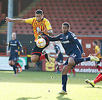 Lyle Taylor and Jamie Reckord go for a ball