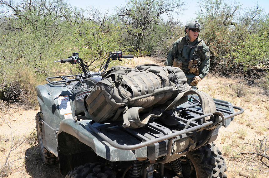 Sasabe, Arizona – A Border Patrol agent from a special unit participates in an event that took a group of journalists on a walk through the Arizona desert. U.S. Customs Border Protection (CBP) transported journalists to this remote area where they walked through a 1.3 miles trail during a two-day event organized by the Tucson Sector Border Patrol. The event brought national and international journalists to the Arizona desert to become acquainted with the dynamics of this area. This area is located near the Sasabe Port of Entry, a border-crossing station located in southern Arizona, and about 70 miles from the City of Tucson. Sasabe is one of the most isolated ports along the 2,000-mile U.S.-Mexico border, and it connects the towns of Sasabe, Arizona and El Sasabe, Sonora (Mexico). The border-crossing station is located in one of the busiest human and drug smuggling corridors of the U.S.-Mexico border. Photo by Eduardo Barraza © 2012