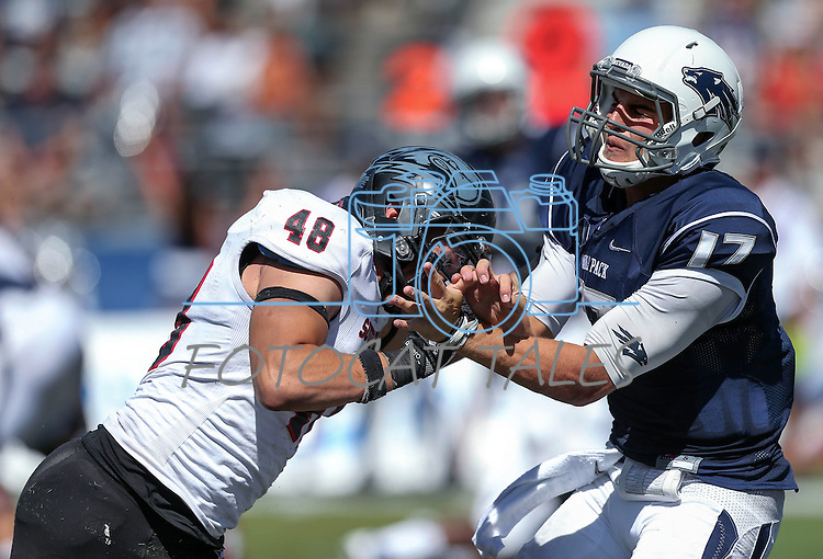Nevada's quarterback Cody Fajardo (17) gets hit by Southern Utah defender Taylor Pili (48) in the second half of an NCAA college football game on Saturday, Aug. 30, 2014 in Reno, Nev. (AP Photo/Cathleen Allison)