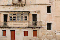 Malta, 28 December 2014<br /> <br /> Along the West shore of the old city of Valetta. A lot of old badly maintained houses.<br /> <br /> Photo Kees Metselaar