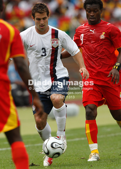 NUREMBERG, GERMANY - JUNE 22:  Carlos Bocanegra of the United States (3) controls the ball against Derek Boateng of Ghana (9) during a 2006 FIFA World Cup soccer match June 22, 2006 in Nuremberg, Germany.  (Photograph by Jonathan P. Larsen)