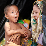 A woman laughs with her child in the Jamtoli Refugee Camp near Cox's Bazar, Bangladesh. More than 600,000 Rohingya have fled government-sanctioned violence in Myanmar for safety in Bangladesh.