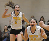 Wantagh No.2 Shannon Hagan, left, and No. 20 Katie Hagan react after their team's victory over South Side in a Nassau County varsity girls' volleyball match at Wantagh High School on Friday, October 23, 2015. Wantagh won 25-15, 25-17, 28-26.<br /> <br /> James Escher