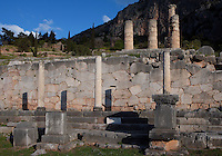 DELPHI, GREECE - APRIL 12 : A general view of the Stoa of the Athenians with the polygonal wall in the background and the remains of the peristasis of the temple of Apollo in the distance, on April 12, 2007 in the Sanctuary of Apollo, Delphi, Greece. The Stoa of the Athenians was erected circa 479BC after the victory of the Athenians in the naval battle of Salamis. The 3 Ionic columns were part of the Ionic stoa with 7 columns. (Photo by Manuel Cohen)