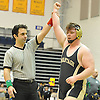 Pat Smith of Wantagh raises his arm after beating Jeffrey Alvarez of Long Beach by decision 1-0 at 285 pounds in the Nassau County Division 1 wrestling quarterfinals at Hofstra University on Saturday, Feb. 13, 2016.