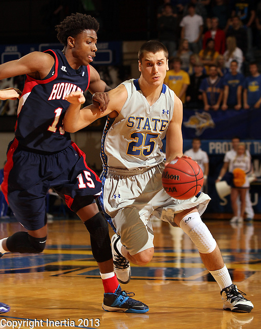 BROOKINGS, SD - NOVEMBER 25:  Chad White #25 from South Dakota State University drives against Damon Collins #15 from Howard in the first half of their game Monday night at Frost Arena in Brookings. (Photo by Dave Eggen/Inertia)
