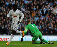 Picture: Andrew Roe/AHPIX LTD, Football, Barclays Premier League, Manchester City v Swansea City, 22/11/14, Etihad Stadium, K.O 3pm<br /> <br /> City's keeper Joe Hart is on the floor as Swansea's Wilfred runs off to celebrate his opener<br /> <br /> Andrew Roe>>>>>>>07826527594