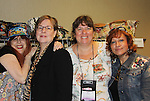 Designer Jane Elissa poses with author Christina Skye, volunteer Kim Adams and Jane's friend Ave at Romantic Times Booklovers Annual Convention 2011 - The Book Industry Event of the Year - April 6th to April 10th at the Westin Bonaventure, Los Angeles, California for readers, authors, booksellers, publishers, editors, agents and tomorrow's novelists - the aspiring writers. (Photo by Sue Coflin/Max Photos)
