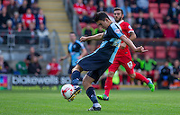 The ball is compressed on Luke O'Nien of Wycombe Wanderers foot as he fires in a shot at goal during the Sky Bet League 2 match between Leyton Orient and Wycombe Wanderers at the Matchroom Stadium, London, England on 19 September 2015. Photo by Andy Rowland.