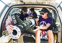 Students from the University of Washington load their rocket to bring to the launch pad at the Spaceport America Cup near the town of Truth or Consequences, New Mexico, Thursday, June 22, 2017. The International Intercollegiate Rocket Engineering Competition hosted over 110 teams from colleges and universities in eleven countries. Students launched solid, liquid, and hybrid rockets to target altitudes of 10,000 and 30,000 feet. The 2017 Spaceport America Cup winner was the University of Michigan, Ann Arbor, Team 79.<br /> <br /> Photo by Matt Nager