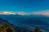 The peaks of the Annapurna Massif with the Pokhara Valley below, seen from Sarangkot,  near Pokhara, Nepal.