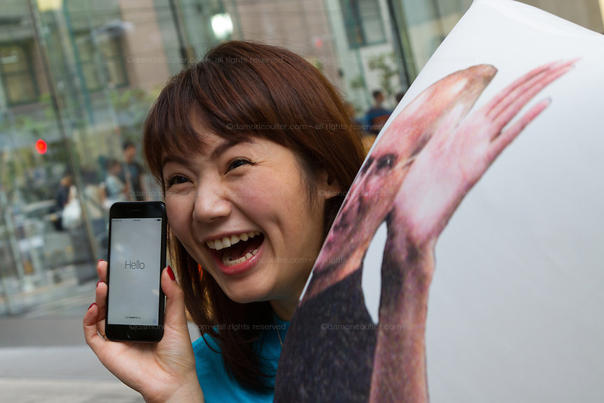 Ayano Tominaga poses with her new iPhone 7 at the launch of the iPhone 7 and iPhone 7 plus at the Apple store in Omotesando, Tokyo, Japan. Friday September 16th 2016. The iPhone launches are global events. Around 200 eager customers waited outside the Apple store in Tokyo, some for several days, to be first in line to buy the new product.