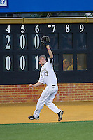 Wake Forest Demon Deacons left fielder Grant Shambley (43) tracks down a fly ball during the game against the Maryland Terrapins at Wake Forest Baseball Park on April 4, 2014 in Winston-Salem, North Carolina.  The Demon Deacons defeated the Terrapins 6-4.  (Brian Westerholt/Four Seam Images)