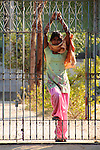 A girl waits at the gate of her family compound in a village in the Shekawati region of Rajashtan.