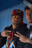 Batavia Muckdogs J.C. Millan (4) and Rony Cabrera (right) in the dugout during a game against the West Virginia Black Bears on June 26, 2017 at Dwyer Stadium in Batavia, New York.  Batavia defeated West Virginia 1-0 in ten innings.  (Mike Janes/Four Seam Images)