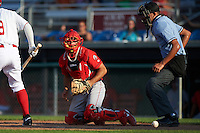 Williamsport Crosscutters catcher Brett Barbier (8) after blocking a pitch in the dirt in front of umpire Emil Jimenez during a game against the Auburn Doubledays on June 26, 2016 at Falcon Park in Auburn, New York.  Auburn defeated Williamsport 3-1.  (Mike Janes/Four Seam Images)
