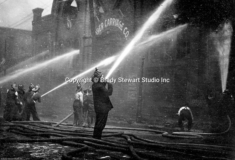 Pittsburgh PA:  City of Pittsburgh firemen fighting a blaze at a local carriage company's offices