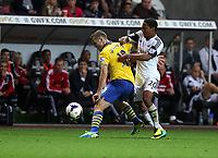 Saturday 28 September 2013<br /> Pictured:  Jonathan de Guzman (R) of Swansea against Jack Wilshere (L) of Arsenal.<br /> Re: Barclay's Premier League, Swansea City FC v Arsenal at the Liberty Stadium, south Wales.